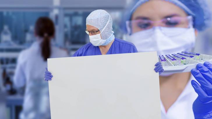 lab workers getting ready for clinical trial