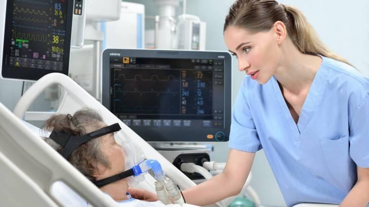 nurse with ventilator patient