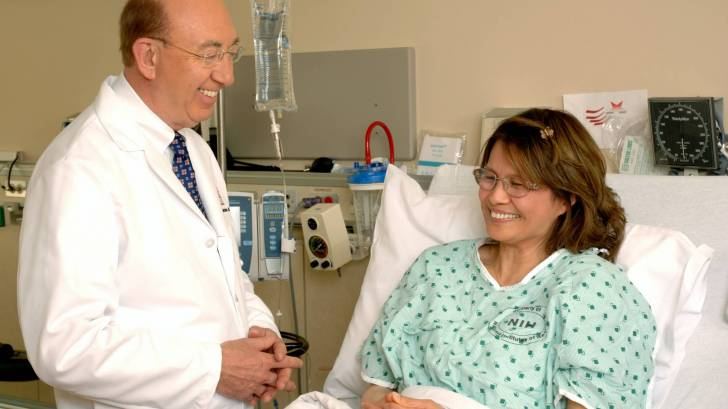 doctor talking to a cancer patient