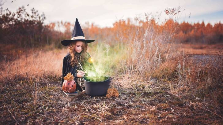 little witch and her cauldrin