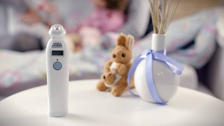 thermometer on bedside table with stuffed animal