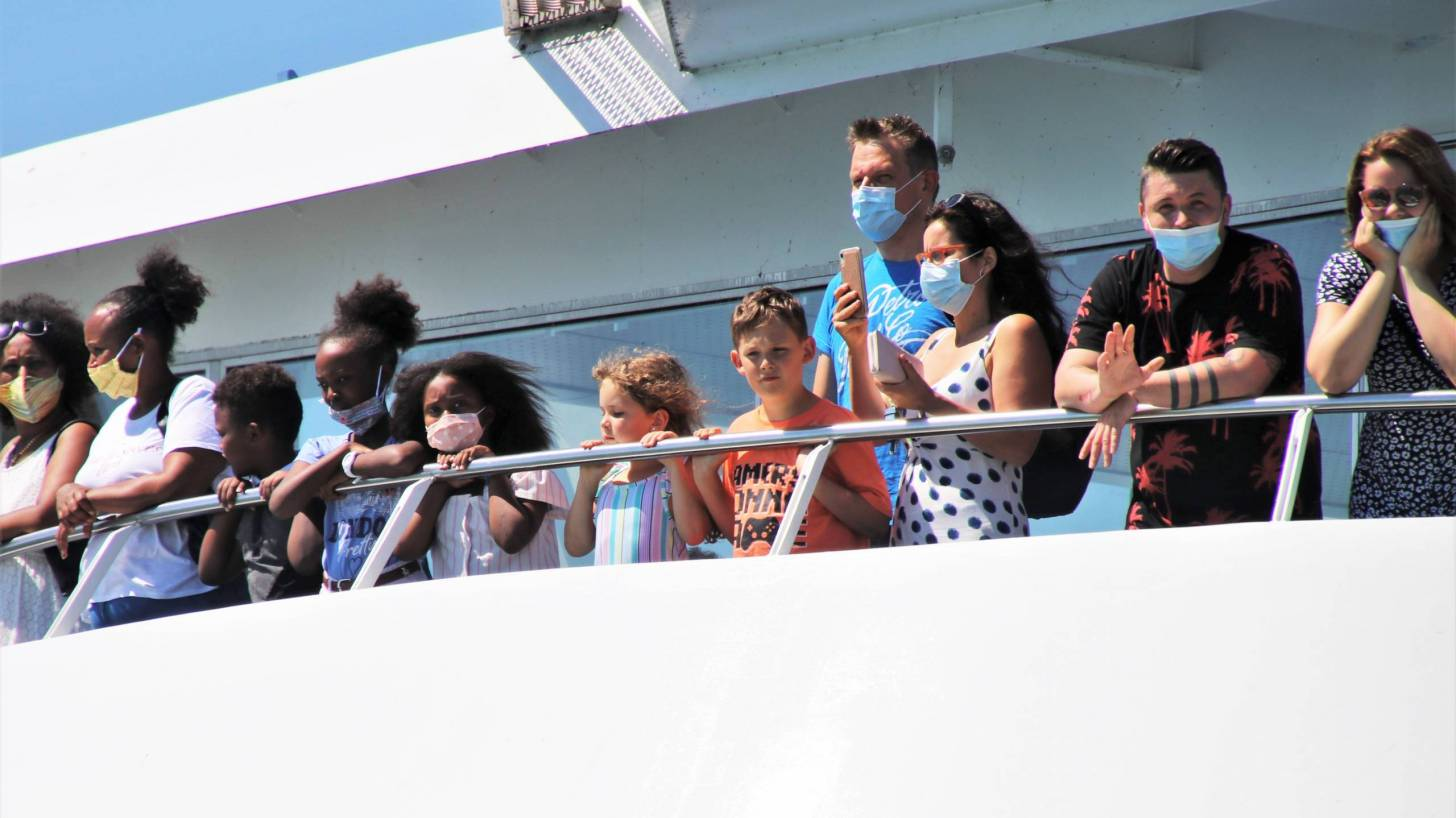 people on ferry boat with masks