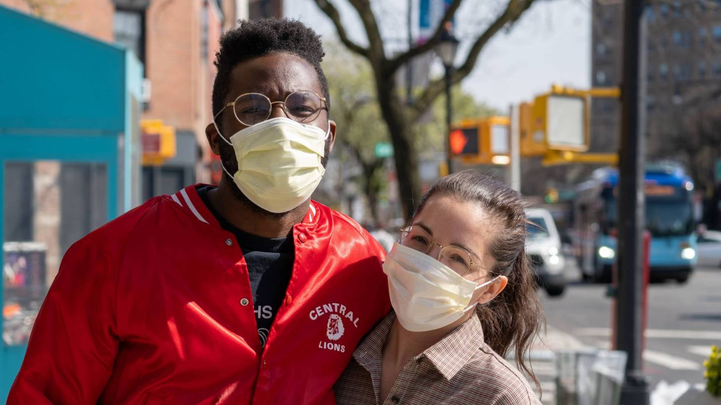 couple outside with masks on in city
