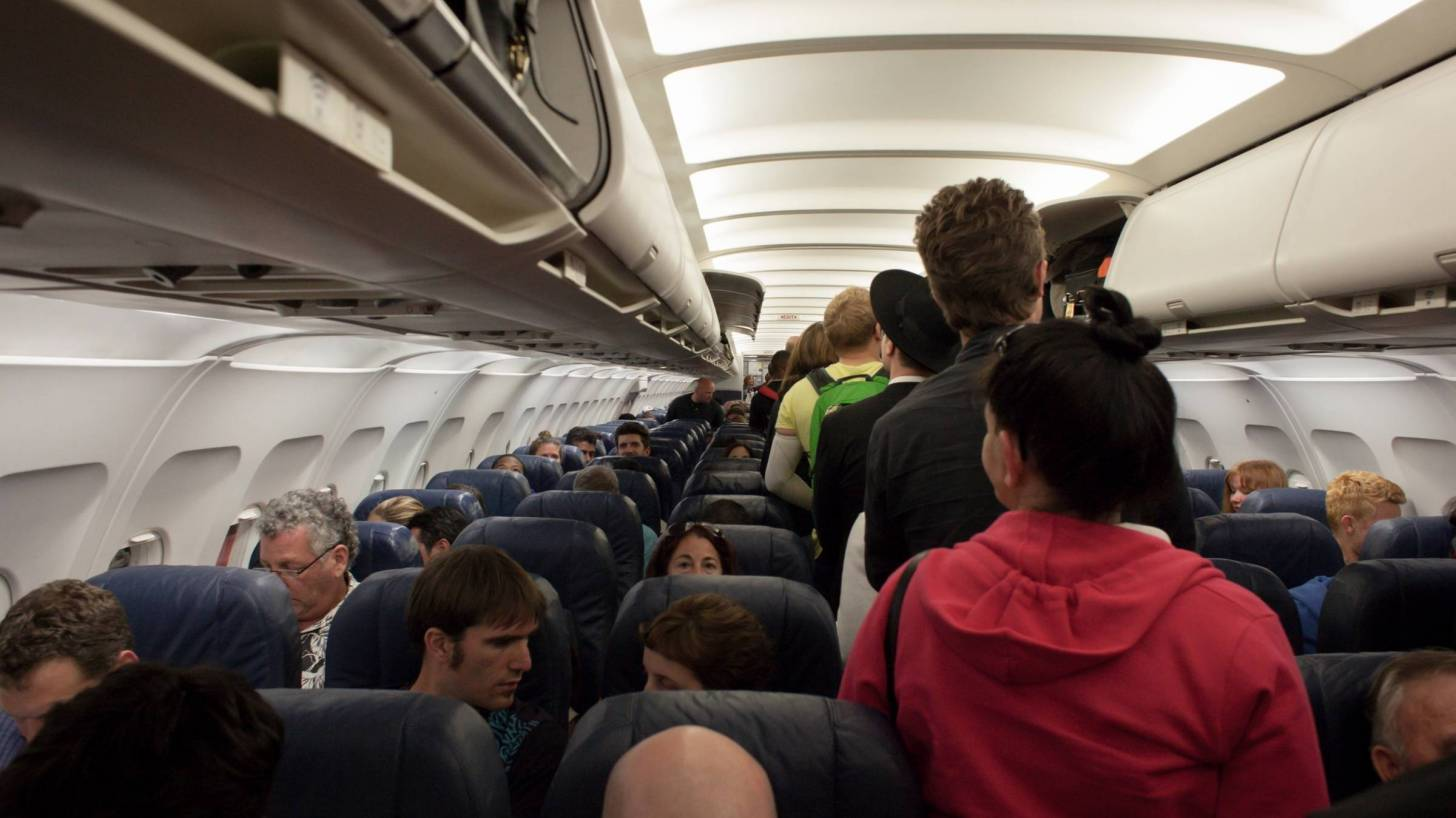 crowded airplane prior to covid
