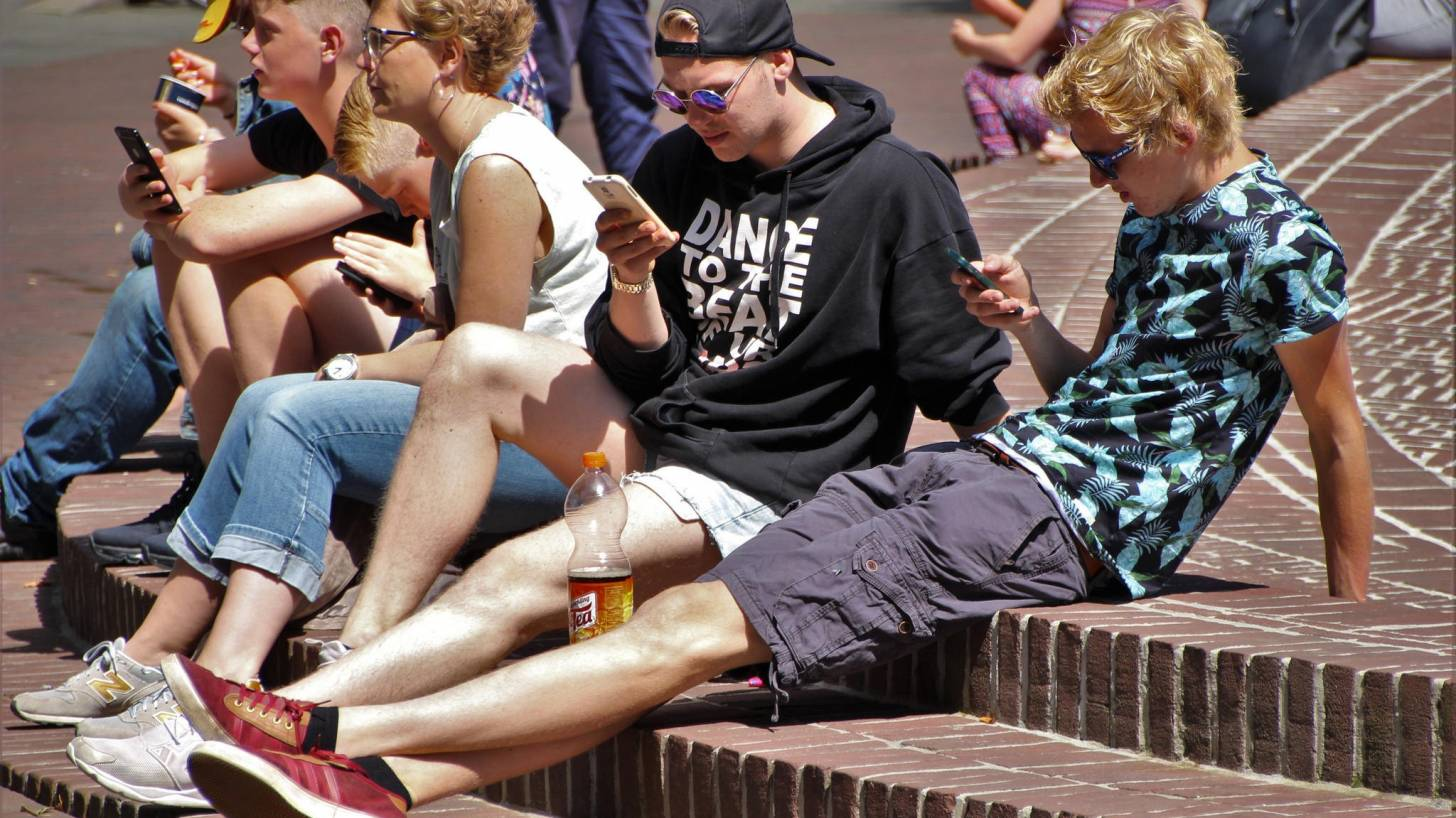 young people on their smart phones being tracked