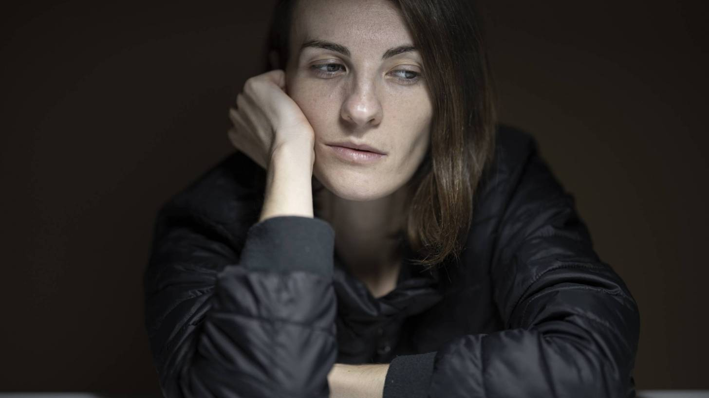 woman not feeling well after covid illness