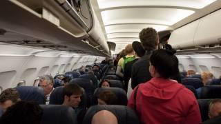 inside an airplane, passengers
