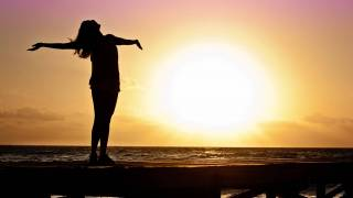 woman celebrating the sun rising, vitamin d natural