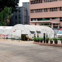 hospital with outside testing tents set up for covid-19