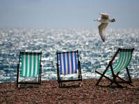 arranging beach chairs on empty beach