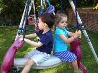 children swinging on playground
