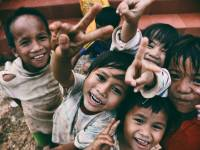 kids smiling at the camera