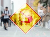 coronavirus masks super imposed over a street full of people