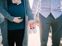 couple with wife pregnant holding hands